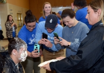 <p>Nate Grabner, PUDM exec board member, has a crowd watching him get pie-ed.</p>