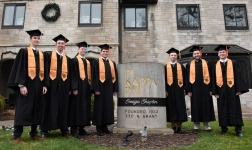 <h5>Pi Kapp Graduates</h5><p>Griffin Engle, Nick Hnatusko, John VanVlliet, Tanner Musser, Tyler Prestholt, Jake Martin and Chris Beck pose in front of the fraternity house on Graduation Day, Dec. 17, 2017</p>