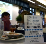 <p>A view of the table favors for the 2018 Moms Day celebration at the Purdue Memorial Union with keynote speaker Basil Lyberg in background</p>