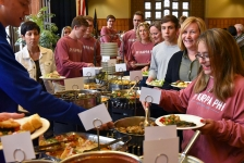 <p>Parents, guests and sons dive into the buffet.</p>